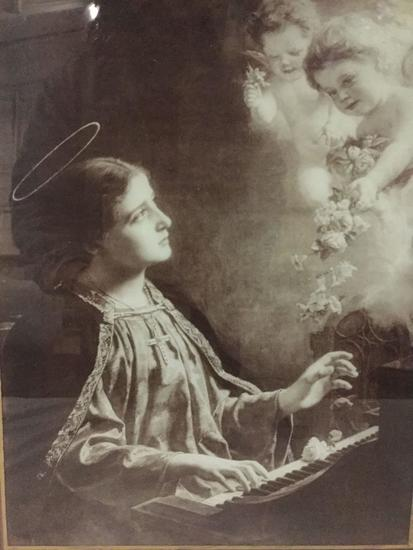 Vintage reverse glass print of St. Teresa