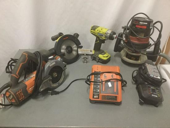 Four power tools and two battery charging stations , Ryobi, Craftsman , Ridgid see description
