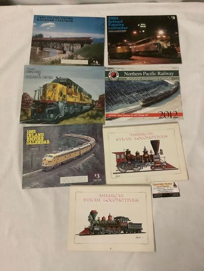 Collection of 7 old railroad calendars and magazines. Inland Empire, Northern Pacific and more