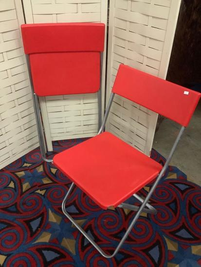 Pair of red IKEA - Jeff folding chairs, approx 20x31x17 inches opened.