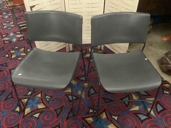 Pair of grey United Chair stacking metal/plastic chairs, approx 19x29x22