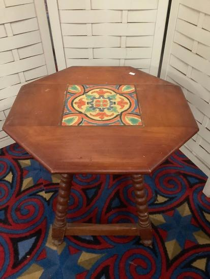 Vintage wooden octagonal small table with decorative tile top, approx 20x20x20 inches.