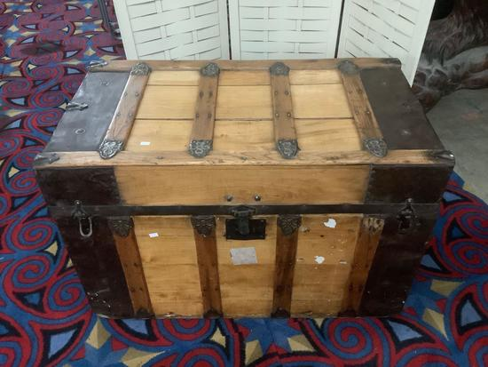 Vintage wooden steamer trunk, missing handles, approx 34 x 19 x 23 inches.