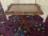 Vintage wood carved small table with removable glass top serving tray, approx 22x21x14 inches.