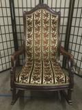 Vintage goose armed rocking chair w/floral upholstery, approx.26x36x43 inches.