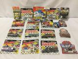 Lot of 16 diecast toy cars in original packages, includes Hot Wheels & Matchbox.