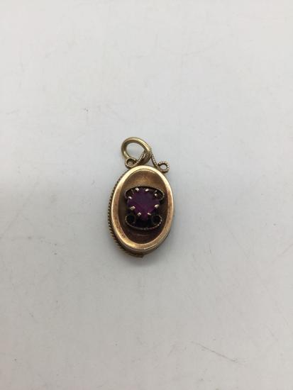 Vintage 14k gold pendant with amethyst stone.