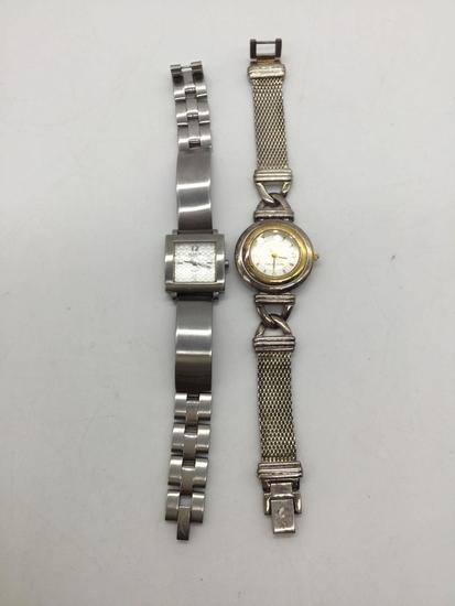 Pair of Ecclissi watches. One is sterling silver.