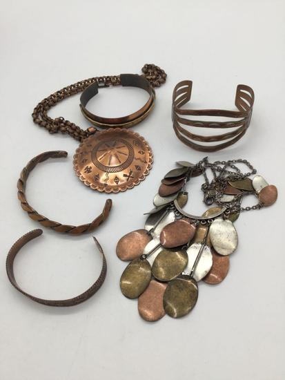Collection of 6 copper and brass bracelets and necklaces.