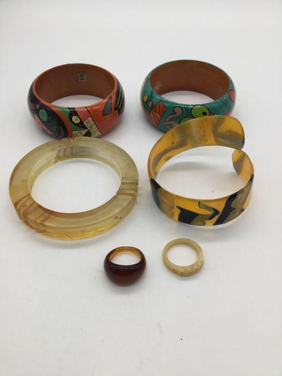 4 bracelets and 2 rings. Bakelite, deco, Mexican, and bone.