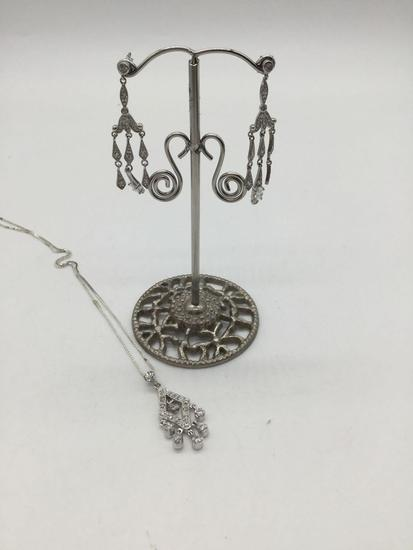 Matching sterling silver necklace and earrings.