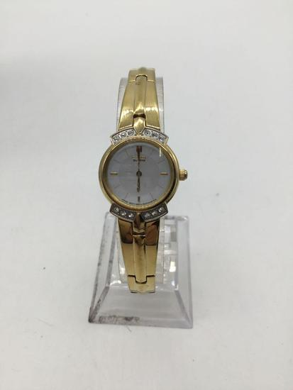Citizen Ecodrive gold tone watch.