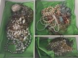 Large collection of estate jewelry. Box measures approx 13x10x2.5 inches.