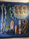 Lot of Native American beaded jewelry, carved arrowheads, beaded purse, necklaces and more