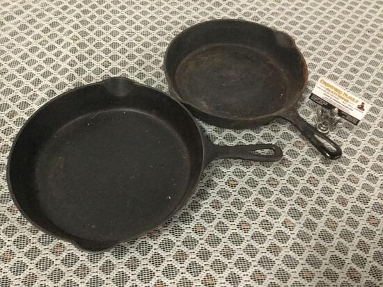 Pair of vintage Griswold small logo cast iron pans. Size 9 710 F, and size 8.