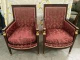 2 French red cushion parlor arm chairs with gold tone claw foot pieces and ladies faces