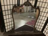 Vintage wood framed mirror with intricate carved detail, has crack in frame - sold as-is