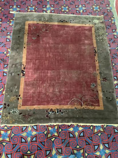 Vintage 100% wool rug with fringe. approx 114x96 inches.