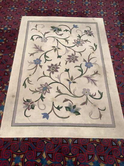 Wool rug with floral pattern. Has some staining. Measures approx 134x92 inches....