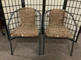Pair of synthetic wicker & metal yard chairs, approx. 22x23x28 inches.
