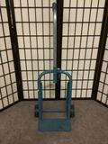 Small blue metal hand truck, approx. 16x13x42 inches.