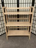 Three tiered wooden shelf, folds down for storage, approx. 28x12x37 inches.