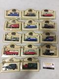 Collection of 14 Chevron commemorative die cast cast and trucks in original packages.