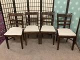 Four wooden chairs w/white cushions from Thailand, approx. 21x18x36 inches each.