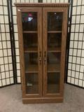 Wooden display cabinet w/adjustable shelves & casters, approx. 23x17x47.5 inches.