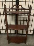 Small wooden three-tiered shelf, approx. 19x7.5x29 inches.