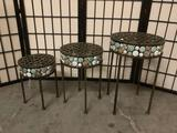 Three squat metal plant holders/display tables w/inlaid stones of varying sizes.