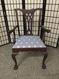 Vintage claw foot wooden arm chair with cabriole legs.