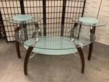 Pair of modern glass top end tables and a coffee table. approx 24x24x26 inches....