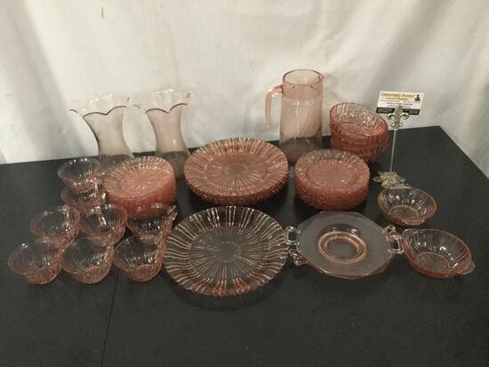 45 pieces of vintage pink depression glass. Largest plate measures approx 10x10 inches.