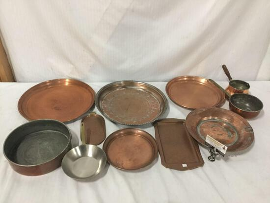 Collection of 11 copper plates and pots. Largest plate measures approx 14x14x2 inches.
