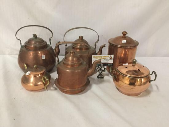 Collection of 6 copper tea ports and dishes. Largest measures approx 8x8x6 inches.