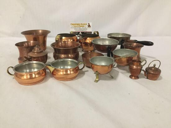 Collection of small copper and brass cookware. Largest measures approx 4x4x3 inches.