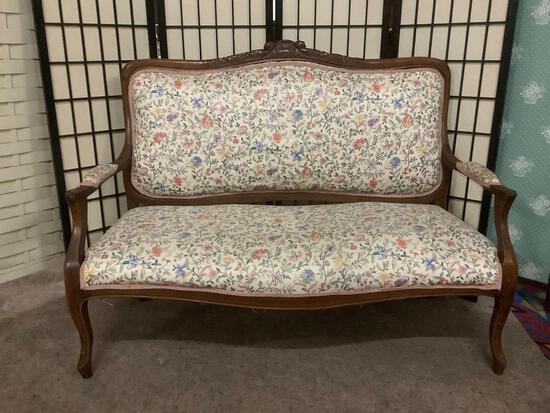 Antique loveseat or settee w/ floral upholstery & carved floral detailing. Some wear, see pics