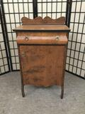 Antique cabinet with drawer, burled finish and carved accents