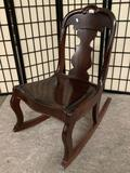 Vintage small wood carved rocking chair, approx 18 x 27 x 30 inches.