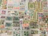 Large lot of around 100 vintage foreign bank notes. Sheets and more.