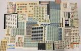 Large collection of full us and foreign postage stamp sheets and more.