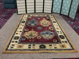 Hand made wool area rug by Direct Home Textile Group. approx. 5x8 feet.
