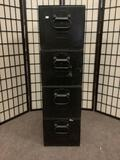 Four metal military filing cabinets w/handles & locks on the back. Measures approx. 13x25x46 inches.