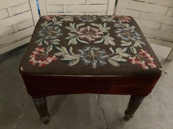 Vintage ottoman with wood carved legs and crocheted floral design upholstery 17x16x14 inches
