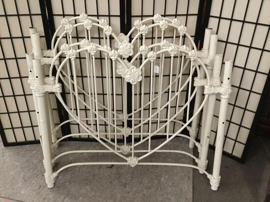 Pair of vintage twin sized metal bed frames w/ heart shaped/flower motif. No rails.