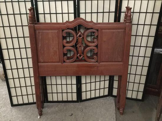 Vintage twin sized wooden bed frame. No rails.