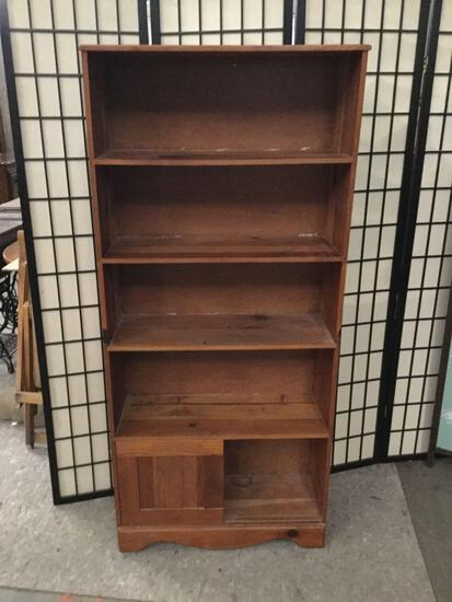 Wooden book shelf with bottom cabinet.