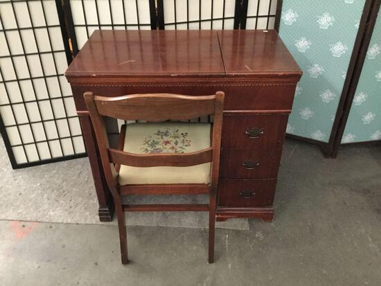 Vintage Sears and Roebuck converged sewing machine desk with chair.