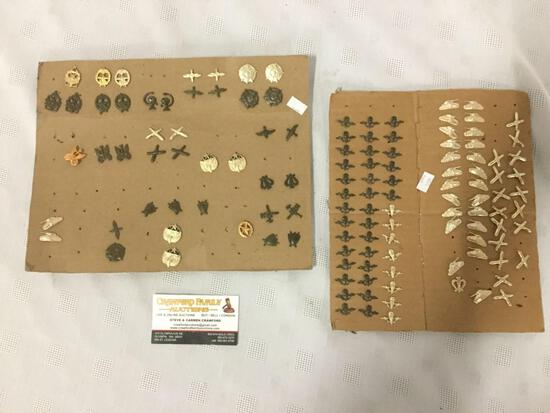 Approx. 138 military pins on two pieces of cardboard, approx. 12x9x0.25 inches.